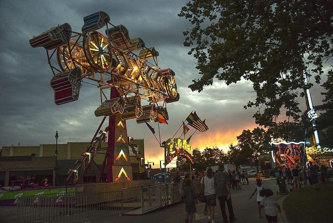 The Zipper ride lights up the sky as the sun sets on the opening night of the Railroad Days Carnival on the Public Square.