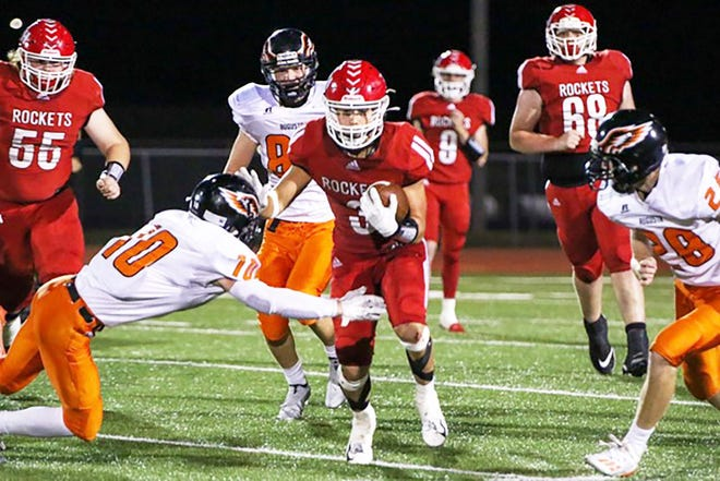 Rose Hill Spencer Nolan (3) runs through the Augusta defense on Friday, Sept. 25 at Rose Hill High SChool. Nolan scored four touchdowns in the 28-26 win over Augusta.