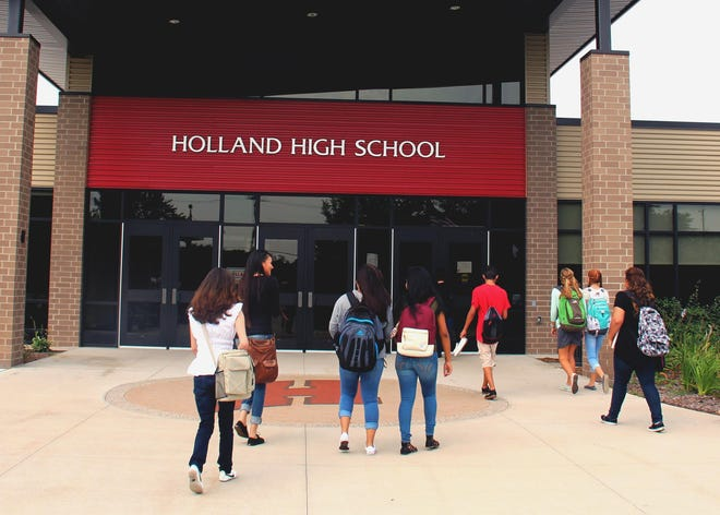 Two Holland Public Schools students, one at Holland Middle School and one at Holland High School, have tested positive for COVID-19.