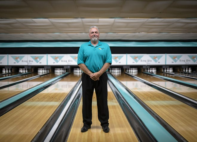 Craig Rhodes, a co-owner of King Pin Lanes in Springfield, will have to close his bowling center on Friday at 12:01 a.m.
