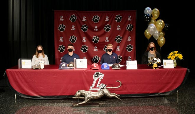 From left: Mikayla Kline, Harrison Booker, Tyler Reynolds and Rachel Wohlford all sign their National Letter's of Intent on Thursday, Nov. 12 at Lakeside High School.