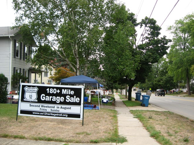 A sign promoting a previous U.S. 12 Heritage Trail Garage Sales in Clinton is pictured. The 2022 U.S. 12 Heritage Trail Garage Sale begins today and continues through the weekend, Aug. 13-15. The sales across the state of Michigan, from New Buffalo to Detroit, with Lenawee County being a part of the sale's path.