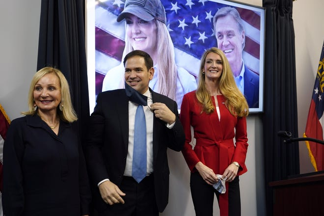 Sen. Marco Rubio, R-Fla., stands with Georgia Republican candidate for Senate Kelly Loeffler, right, and Bonnie Perdue, wife of Sen. David Perdue, R-Ga., after a campaign rally Wednesday, Nov. 11, 2020, in Marietta, Ga.