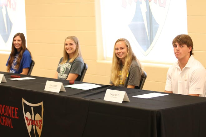 North Oconee student Athletes Maddie Chappell (Golf, Presbyterian),  from left, Lauren Knowles (Lacrosse, Piedmont), Carly Lantz (Soccer, Appalachian State), and David Wiley (Baseball, Wofford) sign Letters of Intent Wednesday at the high school.