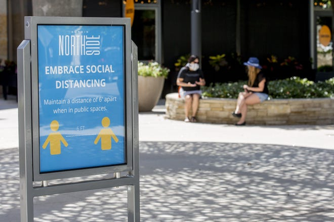 A sign encouraged social distancing at Domain Northside in Austin earlier this year. The local unemployment rate fell to 5.1% in October, its lowest point since the coronavirus pandemic sent the economy into a tailspin.