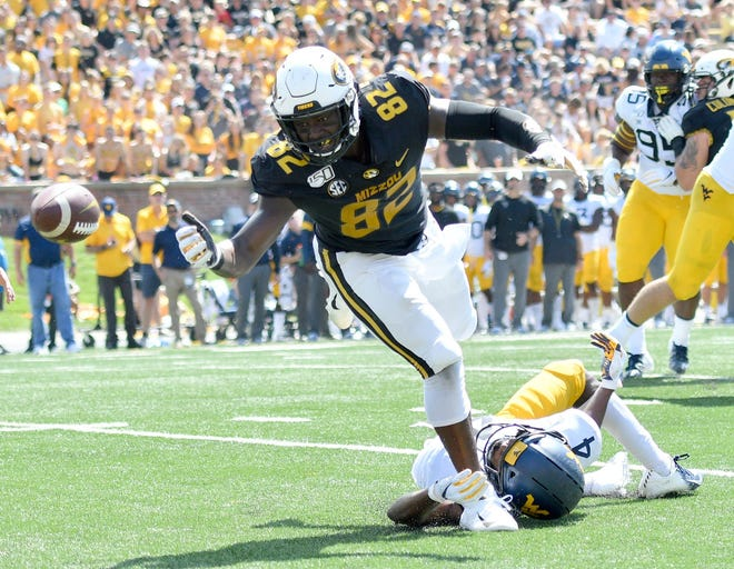 Missouri tight end Daniel Parker Jr. (82) reaches for the ball as West Virginia safety Josh Norwood (4) holds him back during a game Sept. 7, 2019, at Memorial Stadium.