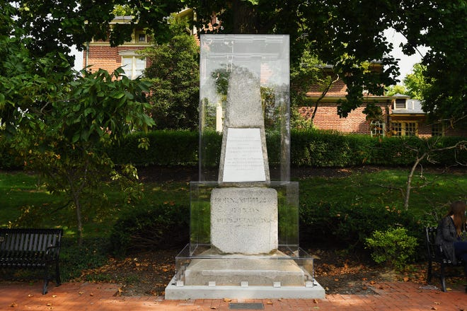 Thomas Jefferson's original tombstone sits on the Francis Quadrangle surrounded by an acrylic case.