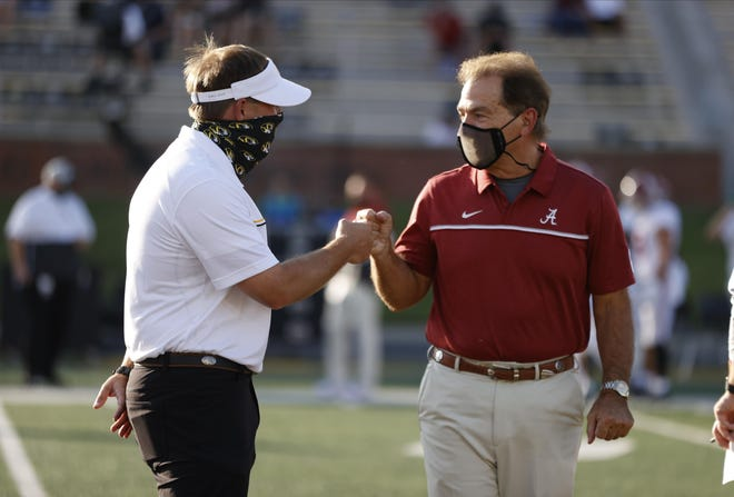 Missouri head coach Eli Drinkwitz bumps fists with Alabama head coach Nick Saban before a Southeastern Conference game Sept. 26 at Faurot Field.