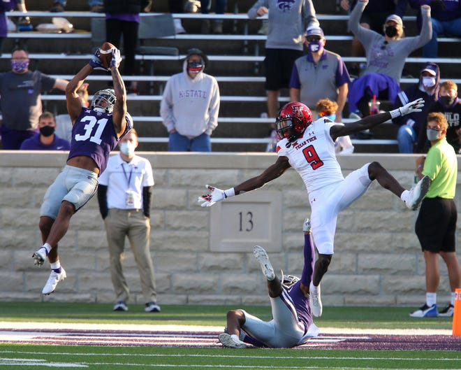 Kansas State safety Jahron McPherson (31) intercepts a pass against Texas Tech last season at Bill Snyder Family Stadium. McPherson is one of four team captains for the 2021 season. [SCOTT SEWELL/USA TODAY SPORTS]