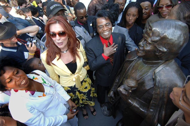 James Brown and Tommie Rae Brown admire his statue after he unveiled it on Broad Street near the Augusta Common Friday evening May 6, 2005.