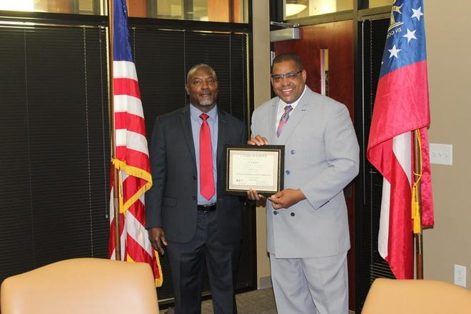 Richmond County Sheriff's Investigator Cecil Ridley (left), receives an award for five years of distinguished service from Sheriff Richard Roundtree in this May 22, 2018 photo.