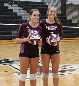 Lakeside seniors Kennedy Powell (left) and Mikayla Kline were honored after the victory over Evans on Tuesday for surpassing milestones. Powell recorded her 1,000th assist and Kline reached 500 kills. The Panthers took down the Knights in three sets on senior night.