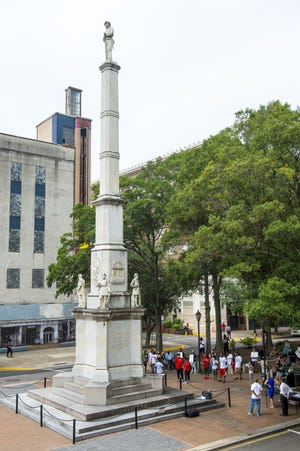 An Augusta task force recommended moving the 76-foot Confederate monument from the median of Broad Street, seen here during an  August rally calling for its removal.