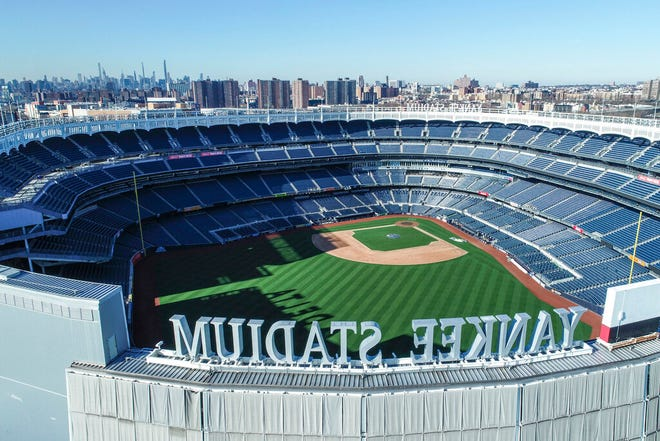 This March 26, 2020 file photo shows an empty Yankee Stadium on opening day due to COVID-19 coronavirus restrictions in the Bronx borough of New York. The Yankees and Mets would train in New York if Major League Baseball and its players try to start the coronavirus-delayed season. New York Gov. Andrew Cuomo made the announcement Saturday, June 20, 2020, and the teams confirmed the decisions.