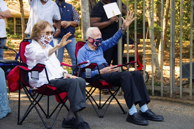 This photo provided by The Carter Center shows former President Jimmy Carter and former first lady Rosalynn Carter, Thursday, Oct. 1, 2020 in Plains, Ga. Former President Jimmy Carter marked his 96th birthday Thursday, the latest milestone for the longest-lived of the 44 men to hold the highest American office.