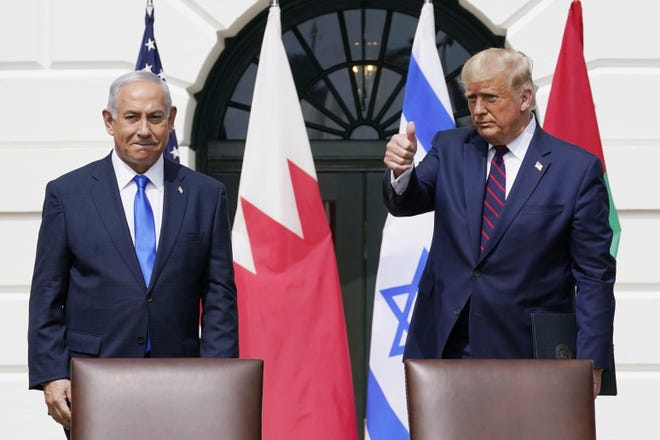 President Donald Trump is shown with Israeli Prime Minister Benjamin Netanyahu during the Abraham Accords signing ceremony at the White House in September. Columnist Jack Bernard writes the Trump administration's Middle East accomplishments include helping to prevent Israel from annexing the West Bank, which would have been the death of the two-state solution, recognizing Israeli sovereignty over the Golan Heights and Jerusalem and moving the U.S. embassy to Jerusalem.