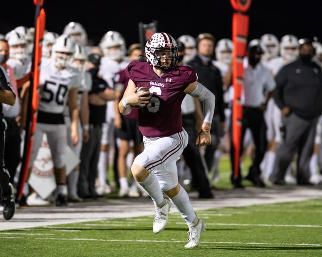 Round Rock quarterback Seth Ford, running during last week's victory over Vandegrift, and the Dragons have won five straight to climb to No. 3 in the weekly Central Texas poll for Class 6A teams.
