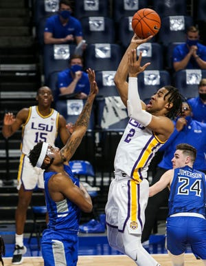 Louisiana State forward Trendon Watford (2) jumps to shoot the ball as Saint Louis guard Jordan Goodwin (0) tries to defend during the first half of an NCAA college basketball game in St. Louis, Mo., Saturday, Nov. 28, 2020.  (Cheyenne Boone/St. Louis Post-Dispatch via AP)