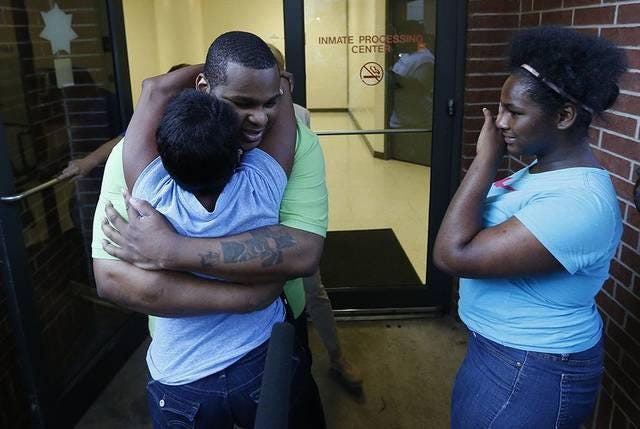 Alfred Dewayne Brown hugs his sister Connie Brown after his release from prison on June 8, 2015.