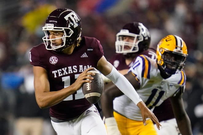 Texas A&M quarterback Kellen Mond is chased out of the pocket by LSU defensive lineman Ali Gaye during the Aggies' 20-7 win Saturday. Mond had his worst game of the year, going 11 of 34 for 105 yards.