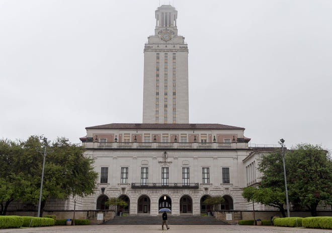 A man walks in front of the UT Tower on the University of Texas campus in March.