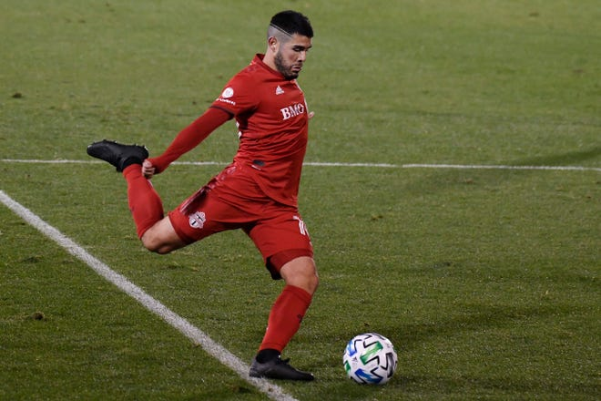 Toronto FC's Alejandro Pozuelo takes a shot on goal during a 2020 playoff match against Nashville SC. Pozuelo was Major League Soccer's most valuable player last season.