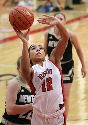 McPherson's Peton Howard (12) shoots the basketball during their game against Newton earlier this season. The Bullpups will host the Mid America Classic Basketball Tournament this week.