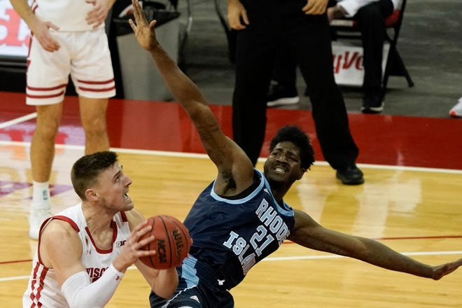 Wisconsin's Micah Potter shoots past Rhode Island's Makhi Mitchell during the second half Wednesday in Madison, Wis. [AP / Morry Gash]