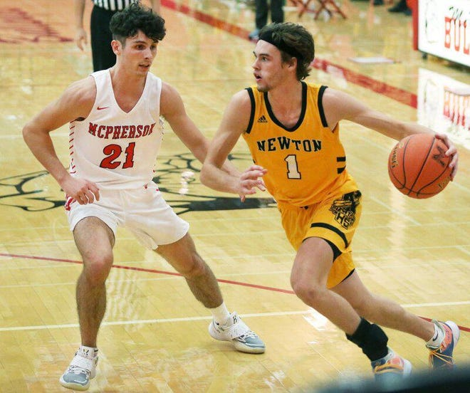 McPherson junior Seth Madron (21) defends against Newton's Jaxon Brackeen (1) earlier this season. Madron and the Bullpups will face No. 1-ranked Bishop Miege in a Class 4A state tournament semifinal Thursday at Tony's Pizza Events Center in Salina.