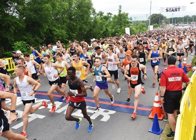 Participants take off from the start line during a recent Boilermaker Road Race. Utica's premier race has been canceled for 2020.