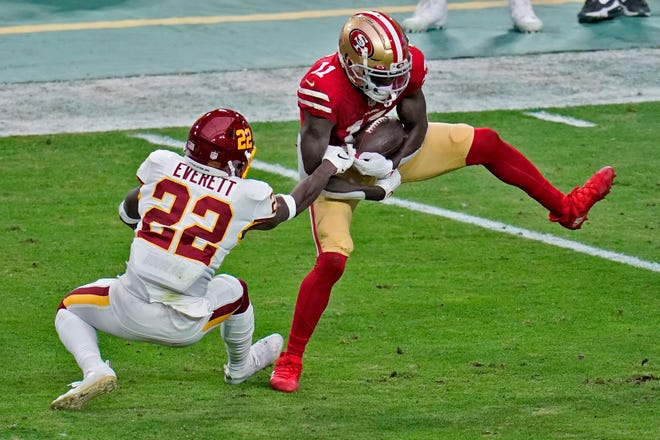 Brandon Aiyuk, making a catch as Washington's Deshazor Everett defends last weekend, has been dynamic and will face the Cowboys this week.