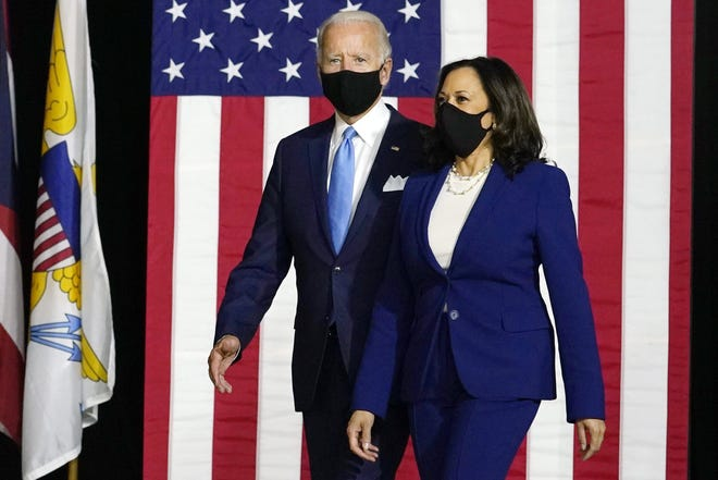 Democratic presidential candidate Joe Biden and his running mate Sen. Kamala Harris, D-Calif., arrive to speak at a news conference at Alexis Dupont High School in Wilmington, Del., last week.