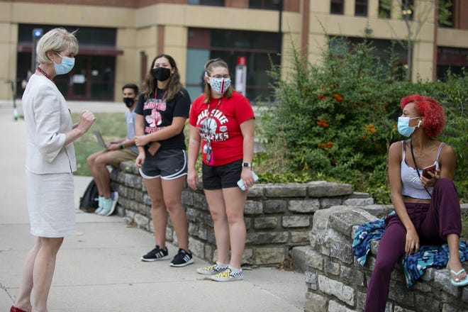 New Ohio State University President Kristina Johnson, left, meets with students as she tours campus on her first day at the university Tuesday.
