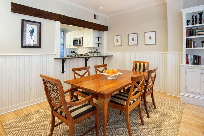 Wide beadboard wainscoting on two walls adds a dash of sophisticated informality to this sizable area where seating six to eight or more people is easy.