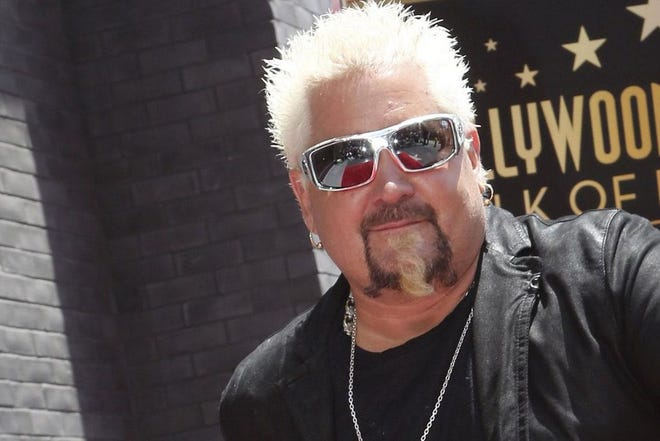 Guy Fieri's Flavortown Kitchen, a new delivery-only concept themed around the Food Network star pictured here, has opened a University Town Center location.