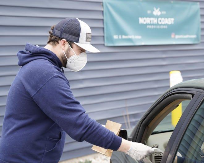 Chris McQuarrie, one of the managers at North Coast Provisions in Adrian, delivers an order to a customer in April.