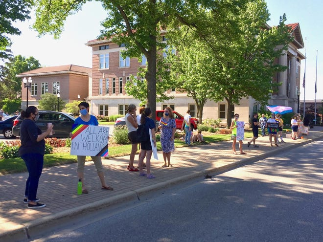 People rally outside Holland City Hall on Wednesday, July 8, 2020, to encourage the city council to pass a non-discrimination ordinance that would include LGBT people as a protected class.
