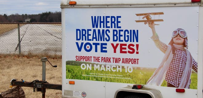 An ad supporting the Park Township Airport appears at the end of the airport's runway in March 2019. Work crews removed the runway last week.