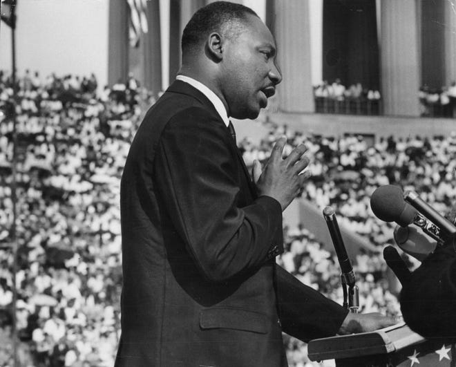 The Rev. Martin Luther King Jr. addresses a crowd at the Illinois Rally for Civil Rights in Chicago on June 21, 1964.