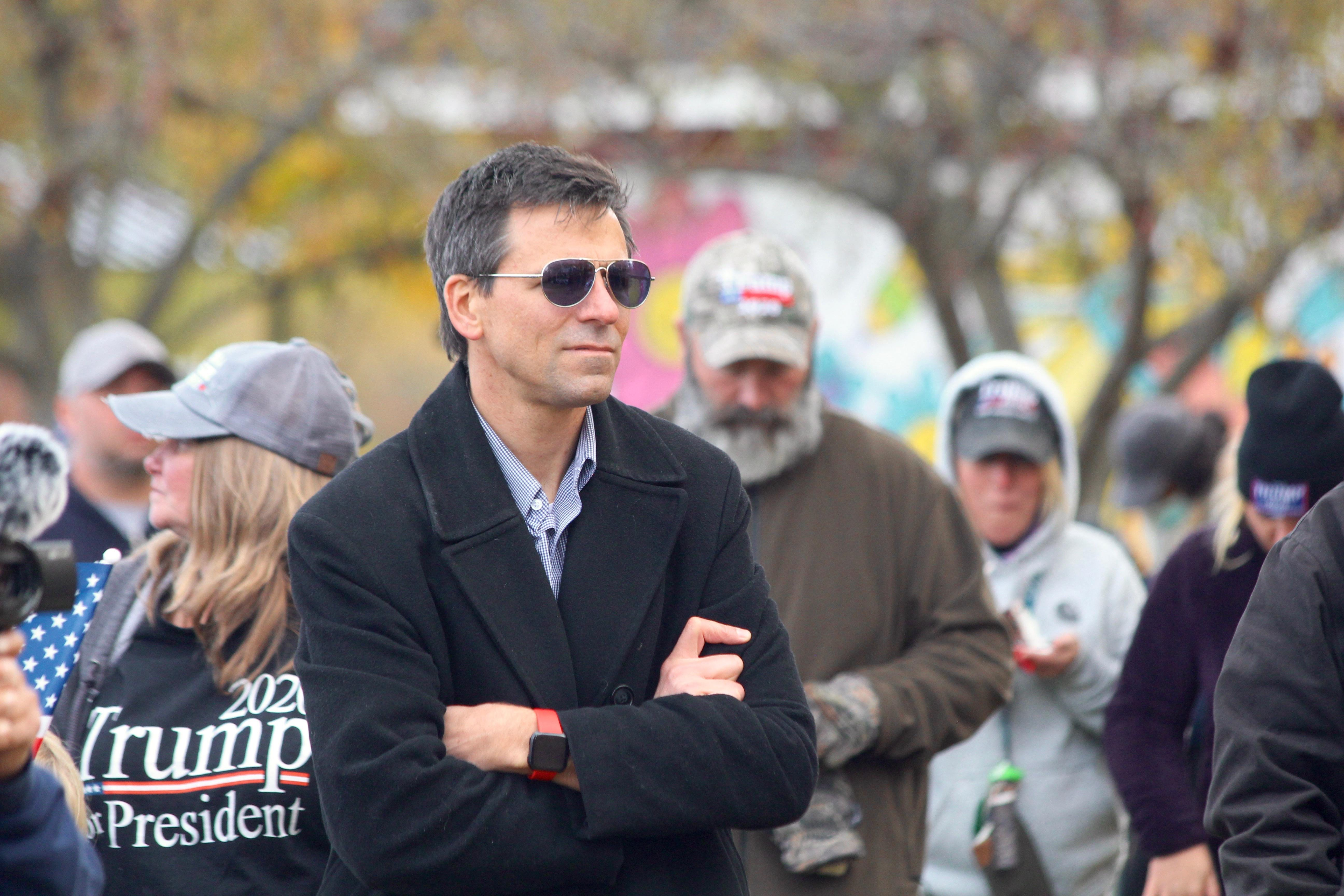 """Ryan Kelley, an Allendale Township planning commissioner, stands during a """"freedom rally"""" in Allendale, Mich., Saturday, Oct. 24, 2020. Kelley has filed paperwork to form a gubernatorial committee, one of the first steps in running for governor."""