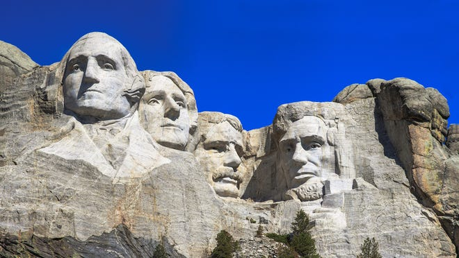 Mount Rushmore National Memorial, opened in 1941 in South Dakota, features 60-foot-high stone visages of  U.S. Presidents (left to right) George Washington, Thomas Jefferson, Theodore Roosevelt and Abraham Lincoln, carved by sculptor Gutzon Borglum into the Black Hills.