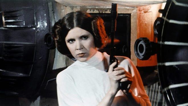 """Carrie Fisher comme princesse Leia """"Guerres des étoiles."""""""