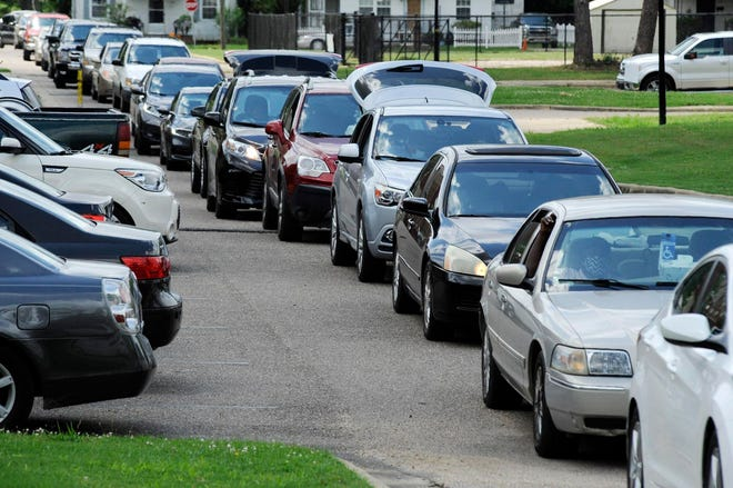 People wait in cars at a site where free food was distributed to residents of Alabama's Black Belt region in Selma on June 4. The region now has the highest percentage of people getting COVID-19 vaccinations in the state, according to numbers released by health officials.