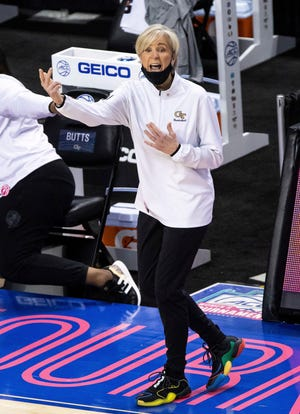 Georgia Tech head coach Nell Fortner shouts to her team during an NCAA college basketball game against North Carolina State in the semifinals of Atlantic Coast Conference tournament in Greensboro, N.C., Saturday, March 6, 2021. (AP Photo/Ben McKeown)