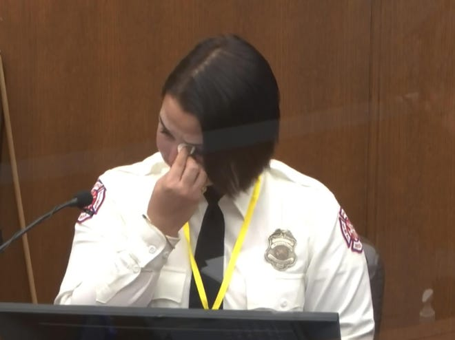 Minneapolis firefighter Genevieve Hansen wipes her eyes Tuesday as she testifies in the trial of former police Officer Derek Chauvin.