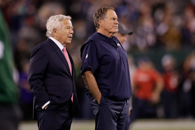 New England Patriots owner Robert Kraft, left, talks to head coach Bill Belichick as their team warms up before an NFL football game against the New York Jets in East Rutherford, N.J., in this Monday, Oct. 21, 2019, file photo. (AP Photo/Adam Hunger, File)