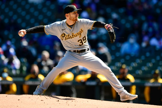 Pittsburgh Pirates starter Chad Kuhl delivers a pitch during the first inning of a baseball game against the Chicago Cubs Thursday, April 1, 2021, on opening day at Wrigley Field in Chicago. (AP Photo/Paul Beaty)