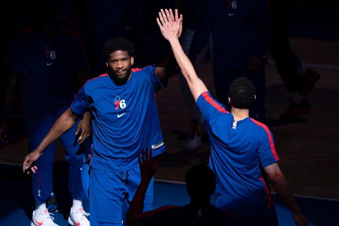 Philadelphia 76ers' Joel Embiid, left, is introduced prior to an NBA basketball game against the Minnesota Timberwolves, Saturday, April 3, 2021, in Philadelphia. (AP Photo/Chris Szagola)
