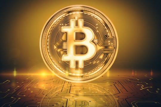 A bitcoin logo on a coin.
