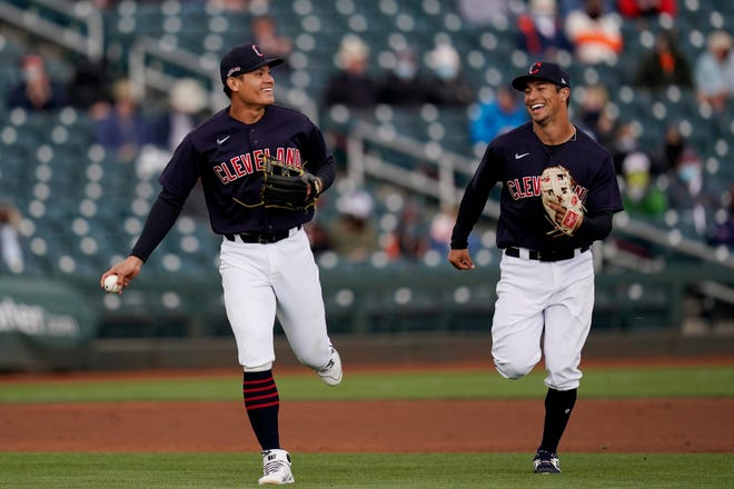 RubberDucks shortstop Tyler Freeman, right, runs off the field with Cleveland infielder Yu Chang during a spring training game in Goodyear, Arizona.. [Ross D. Franklin/Associated Press]